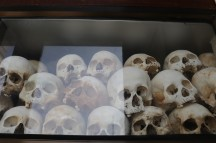 skulls exposed at the killing fields, now placed in memorial